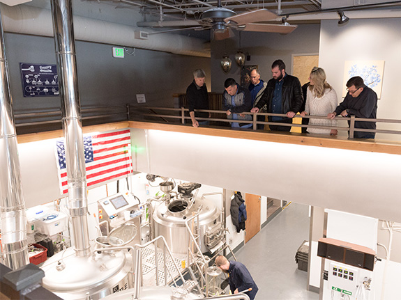 Participants tour brewery