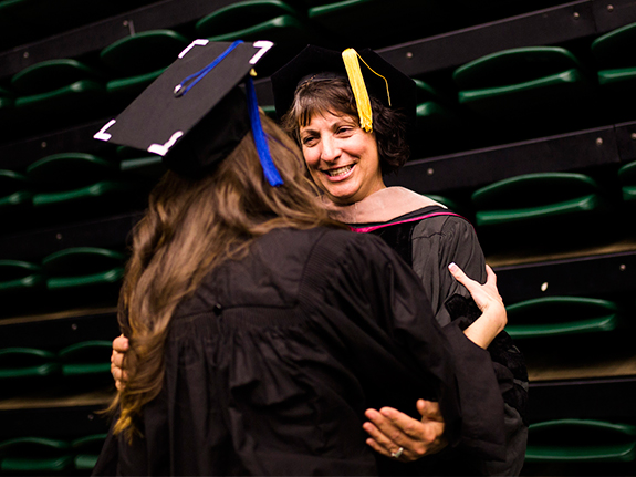 Accounting faculty embraces student at graduation