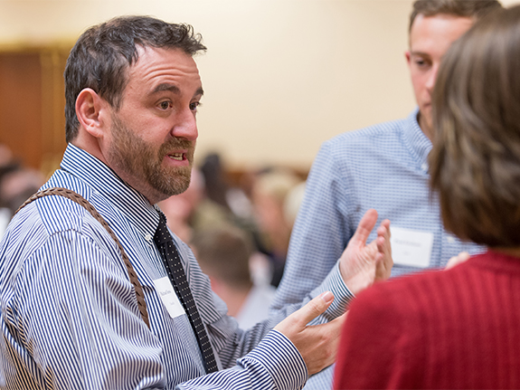 Faculty speaks to students at gathering