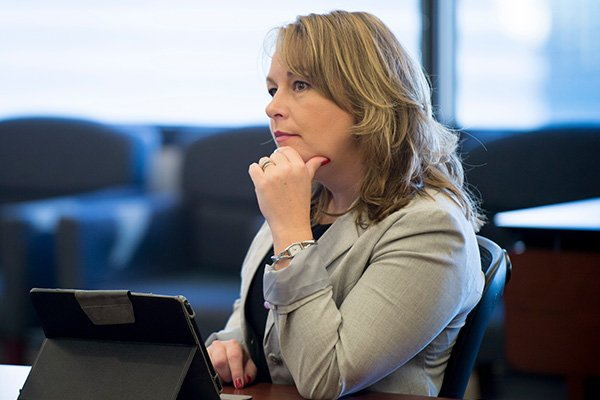 Woman listening in board room