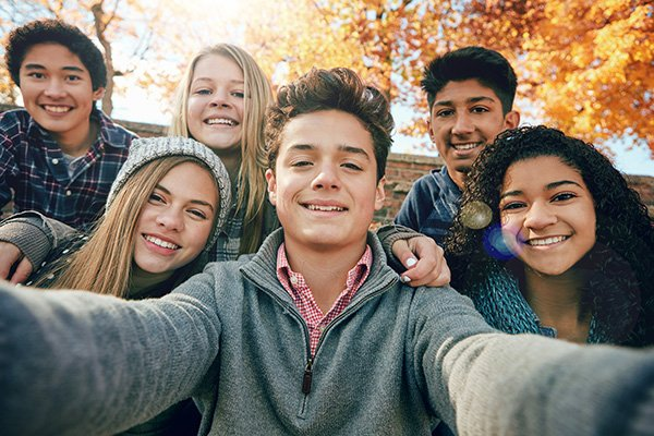 Kids take a group selfie