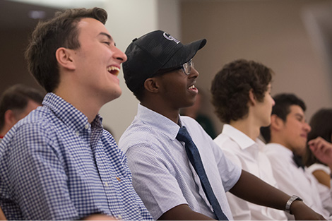 Students laughing during presentation
