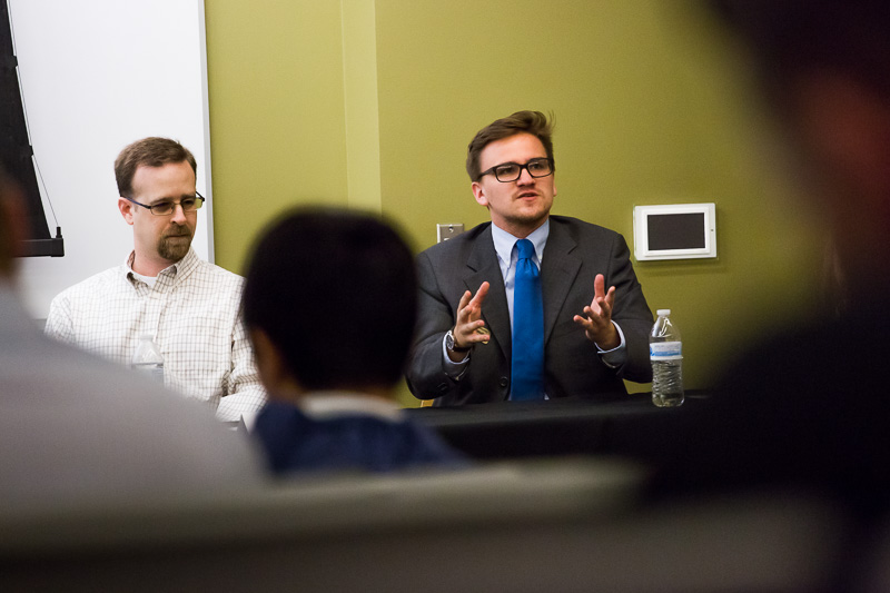 Michael Wells talks to students during a panel discussion about internships at Business Day