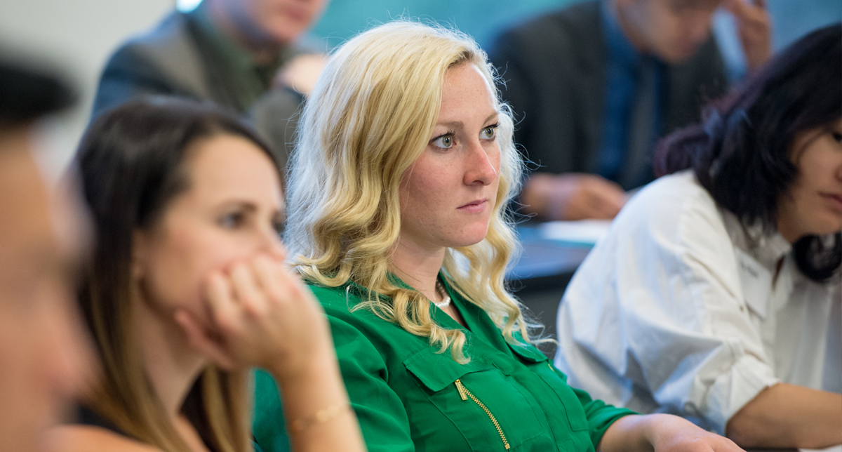 Professional MBA student listens to lecture in classroom