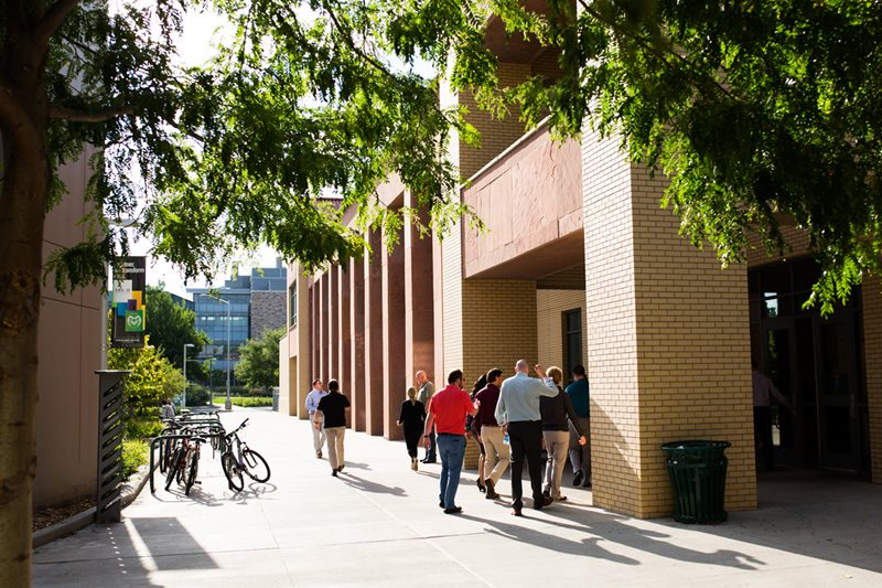 Executive MBA students walk back to class together during their orientation at the College of Business in Fort Collins.