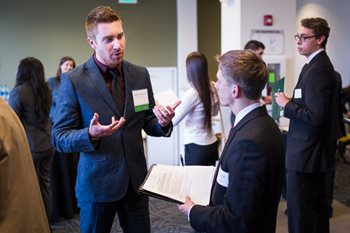 Employers talk to students during the College of Business career expo