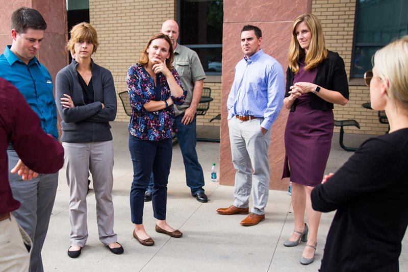 Kristin Mabbutt stands with fellow Executive MBA students during their orientation.