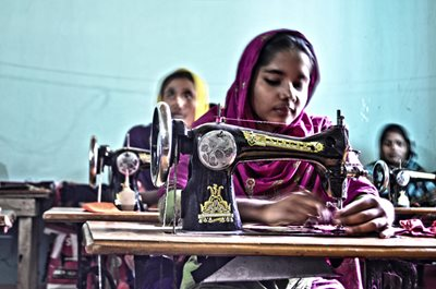 Young garment workers sew fabric in Bangladesh
