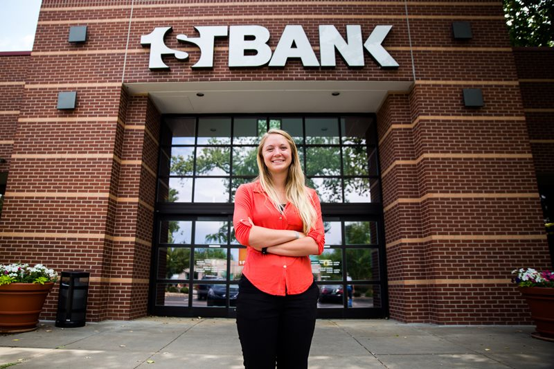 Addie stands in front of FirstBank
